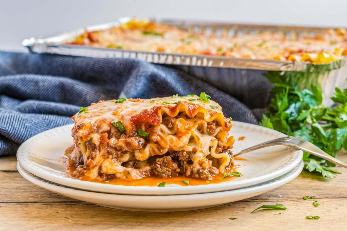 Easy Beef Lasagna on a double white plate with a fork next to it