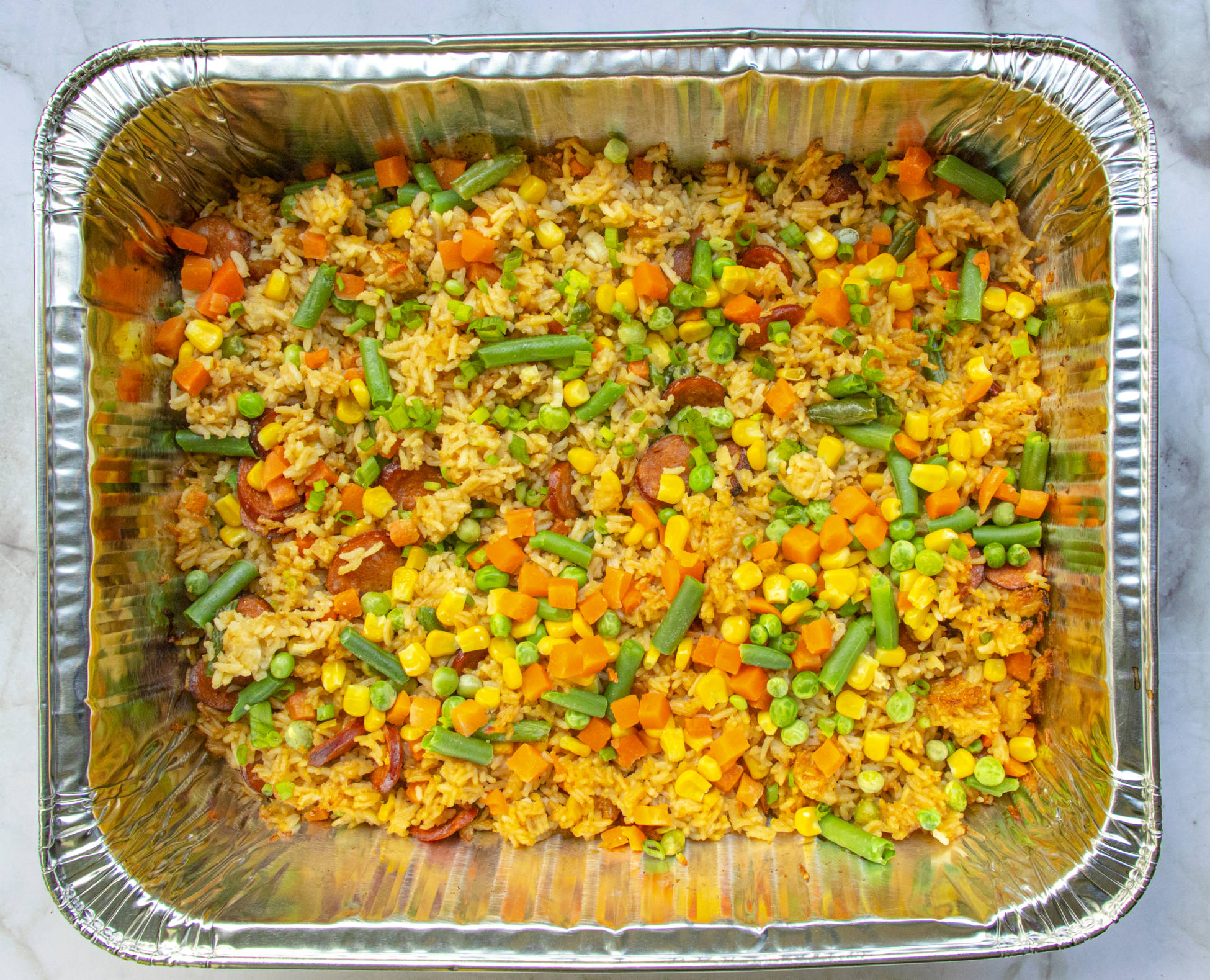 Baked Fried Rice in a steam table pan foil pan